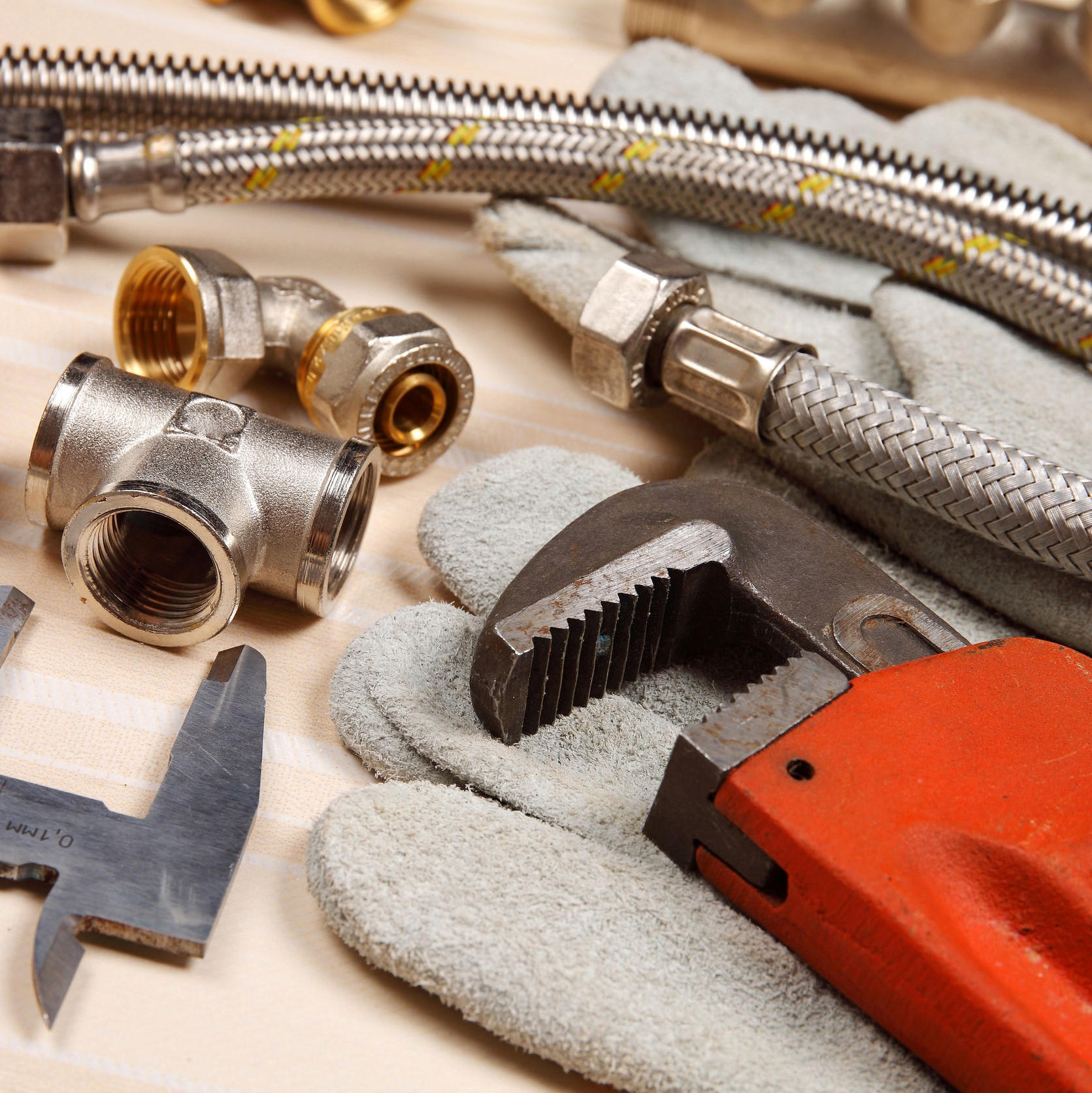 A close up of tools and pipes that are used in plumbing.
