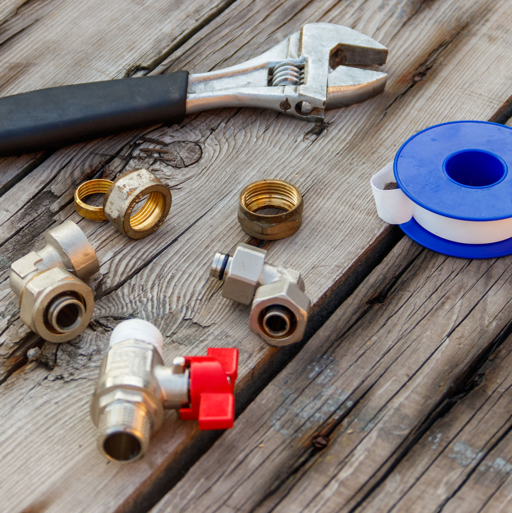 Fittings, valves, and tools lined up to work on a gas line.