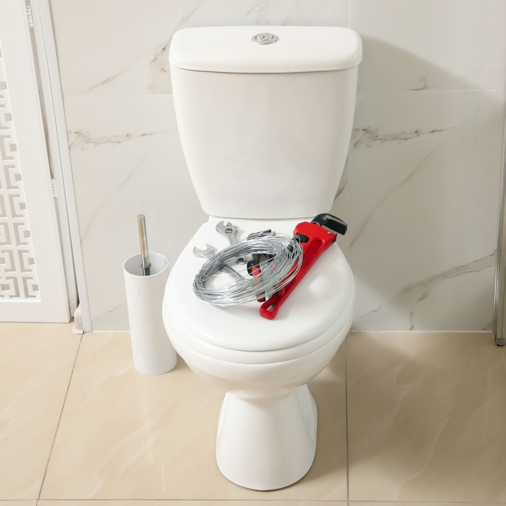 A toilet with tools on it designed to help with leaks and repairs.